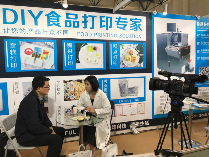 Sinojoinsun Online Food Inkjet Printer was interviewed by State media